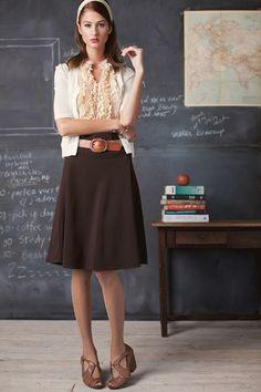 Simple skirt + ruffled blouse.