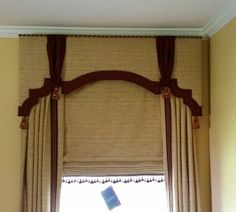 Window cornice with contrast edging, drapes, cornice and shade all with coordinating fabric