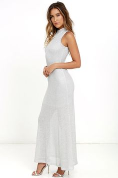 Get ready for your close-up, with the Glow Up Silver Maxi Dress! Shiny silver knit shapes this figure-hugging maxi dress with a mock neckline, sleeveless bodice, and maxi skirt. Exposed silver back zipper.