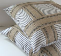 Decorative Pillow Covers of blue and white ticking with upholstery banding embellishment