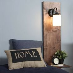 Pop into your local Builders Warehouse for laminated pine to make this wall mounted bedside light and table combination.