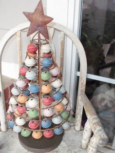 My sister-in-law has a less rustic version of this and I LOVE IT.  I just can't find one to buy.  (Jingle bell Christmas tree)