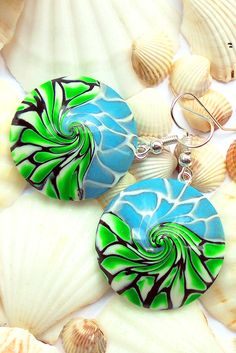 I made new earrings  It took a very long time to pick up the colors. But I think that everything turned out, because my wife said that the earrings were amazing.  I hope you like them, too  On these earrings no paint, only polymer clay, mixed, and twisted in a special way. In real life, earrings look better than in the photo  I will be grateful if you share this publication with your friends and acquaintances  More: https://www.etsy.com/listing/530470674/handmade-green-blue-earrings-sw