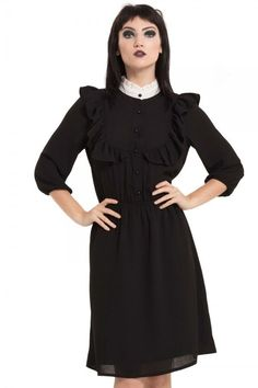 68ba6c56c70 Be a dark delight in the Homicidal Maniac Gothic Dress from Jawbreaker.  This stunning dress features a buttoned bodice with ruffle trim