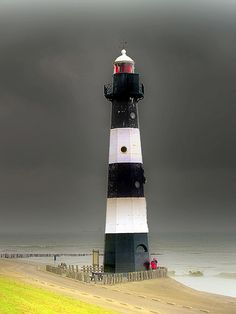 I love the way the lighthouse stands out from the dark gray sky...Breskens Lighthouse, Netherlands