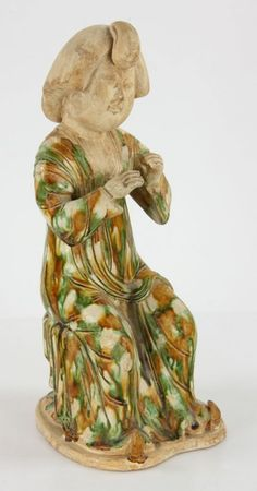 Tang Dynasty Style Sancai Pottery Lady figure, seated with arms folded in front.