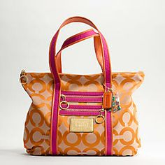Make a smart fashion statement in orange and pink with this Coach canvas tote.