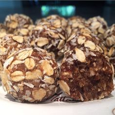 Coconut & Dates Raw Protein Balls No sugar added all natural ingredients 72.6 calories 4.5g of fat 7.3g of carbs 1.76g of fiber 3.2g of sugar & 2g of protein per ball makes 28.  Ingredients: 3/4 cup of shredded unsweetened coconut (1/4 cup will be used for coating) 1/2 cup of unsweetened vanilla almond milk 18 dates 1 cup of gf oats (1/4 cup will be used for coating) 1/2 cup of almond butter 1/4 cup of ground flax meal  In a food processor grind up the pitted dates with the almond milk for a…