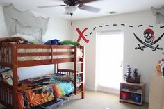 Pirate Bedroom, Pirate themed bedroom with pirate ship decal, skull decal, hanging name on boat paddle, and Lego Pirates bedding., Boys Room...