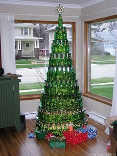 Cool Glass Bottle Christmas Tree! Do you like drinking beer? Do you prefer glass bottles? Do you know that the fun never stops even when the bottle is empty? Here's a great idea for you to recycle those green (or any ) glass bottles into a glamorous tree: