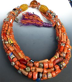 The necklace is one of the finest pieces of Berber tribal jewelry we have ever seen. It's beautifully constructed out of a rich amalgam of antique coral, Berber silver beads, and various antique glass
