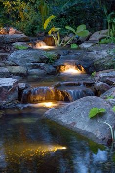 Garden Design Cascading backyard waterfall lit up at night! - With today's busy lifestyle, it can be difficult to enjoy your pond during the day. Underwater lights create a whole new experience by your pond after the sun goes down. Pond Design, Garden Design, Landscape Design, Backyard Water Feature, Backyard Ponds, Backyard Waterfalls, Garden Ponds, Backyard Ideas, Koi Ponds