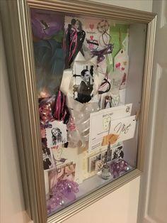 Keep wedding momentos in a shadow box so you can always enjoy them