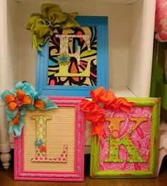 wooden letter on picture frame with scrapbook paper. Might be a unique, although pricey, way to display the alphabet in my classroom :-)