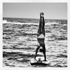 Handstand on stand up paddle board. I impressive for the sea!