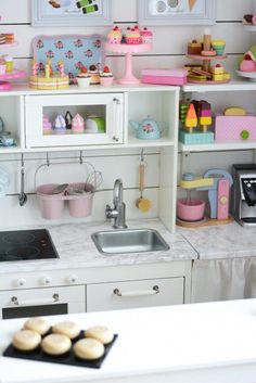 counter and shelves next to ikea kitchen More #kidstoyonline
