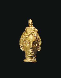 A GREEK GOLD FEMALE HEAD PENDANT LATE CLASSICAL TO EARLY HELLENISTIC PERIOD, CIRCA 4TH CENTURY B.C.
