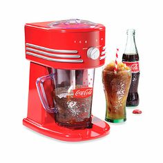 The Nostalgia Electrics Coca-Cola Frozen Beverage Maker all-in-one frozen drink machine will make perfect slush drinks, margaritas, daiquiris, smoothies and more. The two ice shaving options allow you to choose a fine or coarse shaved ice texture. Machine A Granita, Slush Machine, Slush Ice, Frozen Drink Machine, Smoothie Mixer, Ice Texture, Snow Cones, Frozen Drinks, Kitchen Gadgets