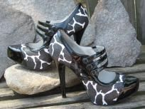 Black and white large giraffe pattern high heels. $39 Be sure and follow for more quality and unique items for sale...thanks :}