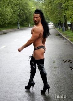 Muscle man in sexy boots