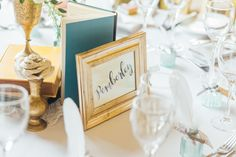 Vintage books & brass wedding table centrepiece with book page flower (Photo by Helena Dolby Photography)