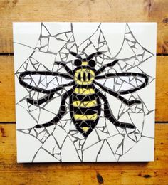 Inspired by the worker bee that has been the symbol of Manchester since the Industrial Revolution. A hive of traditional bee mosaics and cotton flo. Mosaic Tile Designs, Mosaic Patterns, Mosaic Tiles, Mosaics, Bee Tattoo Manchester, Manchester Worker Bee, Revolution Tattoo, Mosaic Tattoo, Black And White Bee