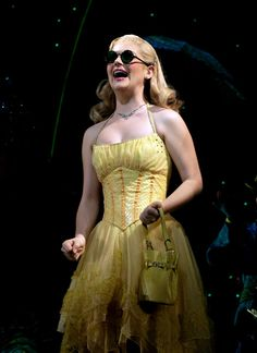 She wears a rhinestone necklace which shows her femininity along with her yellow dress. Her dress shows a lot of skin which shows that she is not conservative. She has a little yellow handbag. Wicked Costumes, Broadway Costumes, Broadway Plays, Broadway Shows, Wicked Musical, Musical Theatre, Yellow Costume, Costume Dress, Costume Box