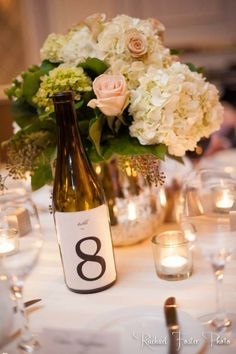 Wine Theme Wedding Ideas: Use old wine bottles for table numbers.  Photo by Rachael Foster Photography  Floral Centerpiece by Chris Johnson at Evergreen Floral Group in Washington, DC area http://www.yelp.com/biz/the-evergreen-floral-group-arlington