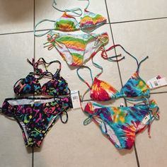 Roxy Bikini's - All Brand New NWT: All three brand new Roxy Bikinis, 2 still have the tags, 1 is without but never been used.. Great friend donation as she has so many...Buy 3 items get 15% discount    All proceeds from sales going to help a firefighters two minor children who lost their mom in a recent tragedy.   Thank you. Have a beautiful & blessed day. Roxy Swim Bikinis