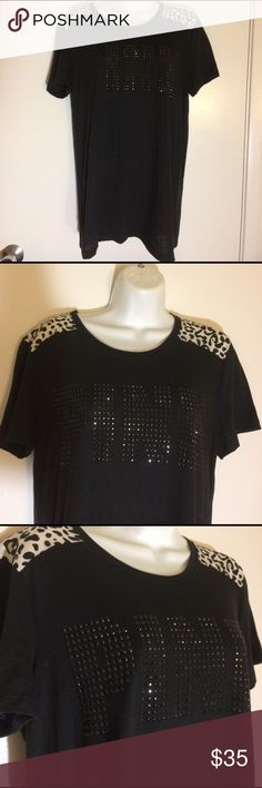 BNWTS VICTORIAS SECRET RHINESTONE T-SHIRT Victoria's Secret T-shirt. Size small. Runs a little big could fit medium. Brand-new with tags. White and black leopard shoulders. It  has a rhinestone front chest. No flaws perfect condition. Wrapped and shipped with care. Victoria's Secret Tops Tees - Short Sleeve
