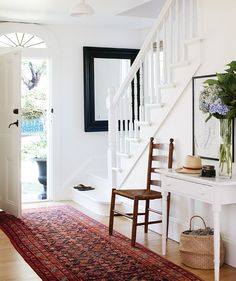 Get a fresh spin on your classic entryway console table! Discover fresh alternatives to popular design trends in our online series, Updated Classics. Foyer Furniture, Entryway Console Table, Entryway Stairs, Modern Entryway, Benjamin Moore Cloud White, Most Popular Paint Colors, White Staircase, Staircase Diy, Foyer Decorating