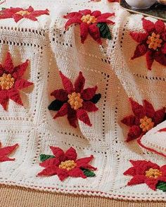 NEW PB183 - Poinsettia Afghan & Pillow Set Crochet Pattern Christmas is often considered the most festive holiday, with many options available for Christmas crochet patterns that will add to your home decor. The Poinsettia Afghan & Pillow Set Crochet Pattern is one of those crochet patterns you will want to work on right away. Buy your copy here: http://www.maggiescrochet.com/products/poinsettia-afghan-pillow-set-crochet-pattern