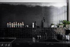 All black kitchen with black Moroccan tile and steel backsplash