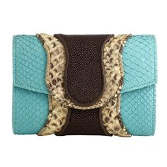 Python Jolie Clutch. Bright hues mixed with luxe materials. Layers of shagreen and snakeskin piped in leather