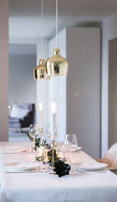 Winter and christmas table decor. Brass, white, green. Artek Golden Bell -lamps…