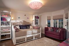 "Eclectic Kids Bedroom with Hardwood floors, Wall sconce, Sauder Harbor View 72.25"" Bookcase, Crown molding, Compact Loveseat"