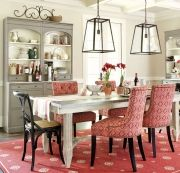 Dining rooms are a great place to go bold -- use a red rug and red chairs to make a statement!