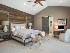 Modern Rustic. Barnwood wall, sliding barn door for bathroom, warm grays. Would look beautiful with ceiling beams.