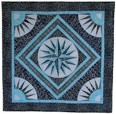 "Mariner's compass, 35 x 35"" pattern and kit for foundation piecing. Love the combination of graphic black-and-white prints with pale blue stars."