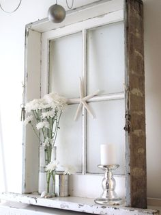 build a frame around old window to create a shelf.  LOVE this look.  This one came all intact but a few strips of wood nailed together and then to the window frame would work just as well.