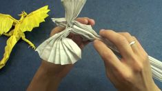 How to make an Origami Phoenix (Kamiya Satoshi phoenix 3.5) - Uploaded on Jun 24, 2011 Like my fanpage me on Facebook to be the first to know what my next video will be! http://www.facebook.com/TadashiOrigami  Origami Phoenix Tutorial: Instructions made using the CP (Crease Pattern) This tutorial is NOT official. Actually, there are no official tutorial, only the crease pattern, so this video is made to help you to fold the CP.  Kamiya Satoshi CP: http://folders.jp/g/2002/0231.html PDF