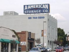 """The Bekins Storage Co.Sign is a rooftop sign at 511 South Fair Oaks Ave. in Pasadena, CA. The original Bekins sign used light bulbs to spell """"STANDARD FIREPROOF STORAGE CO,"""" the same year that Route 66 was routed past the building.  In 1929, its owner replaced the bulbs with neon and the text became """"BEKINS STORAGE CO."""" Now A-American, the sign is Pasadena's only pre-war example of the once-popular massive projecting roof signs designed to attract customers in automobiles."""