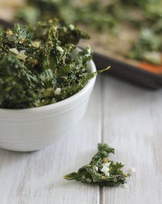 These crispy coconut garlic kale chips are healthy snacking at it's best. Kale is coated in a garlic coconut milk mixture and baked until crispy.