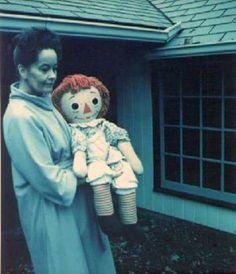 The real Annabelle doll held by Lorain Warren.