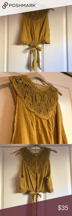NWOT Free People top Mustard crop top with floral stitching at top, button and tie closure in back. NWOT, never worn. Free People Tops Tank Tops