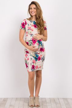 This gorgeous floral maternity dress is the perfect piece to dress up or down for any occasion. A soft and stretchy material will easily accommodate your growing bump, while a bright hued floral print is just in time for spring. Style this dress with a neutral wedge and add your favorite accessories for a complete ensemble.