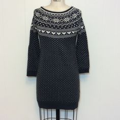 """Charcoal Gray Sweater Tunic/Dress Sm/Med Charcoal gray sweater tunic/dress with white hearts and maybe those are snowflakes. Would look so cute with leggings and tall boots. The sleeves are 18"""" long, shoulder to hem is 29"""" and pit to pit is 16"""". 100% acrylic. F&F Dresses"""