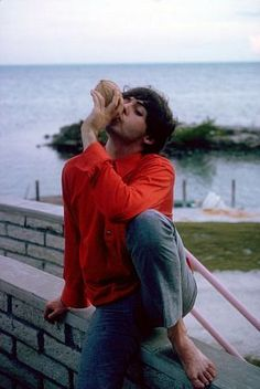 The Beatles, (Paul McCartney jugging the juice out of a coconut), 1964