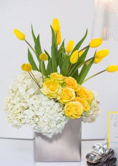 Vibrant yellow centerpiece by Simply Mox. Photo by John Cain Photography.