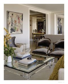 Luxuriate in the Living Room. Soft greys, silk velvet chairs, and a lucite coffee table. Interior Designer: Candace Cavanaugh
